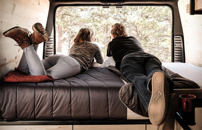 two people in a van looking out the window