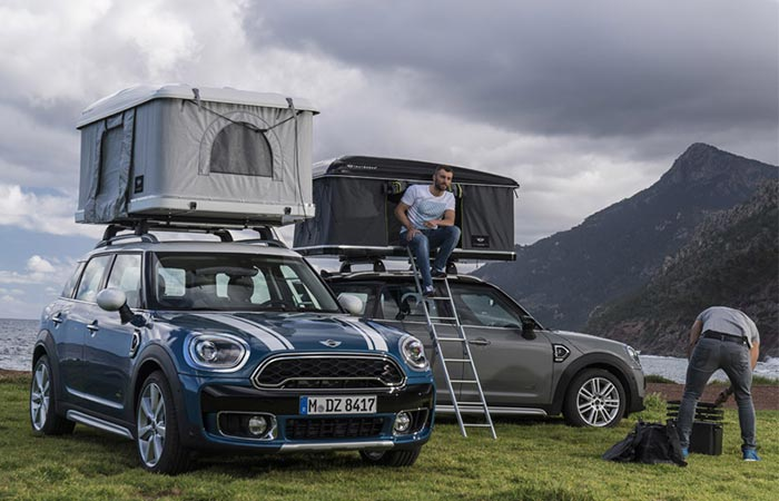 two cars with rooftop tents