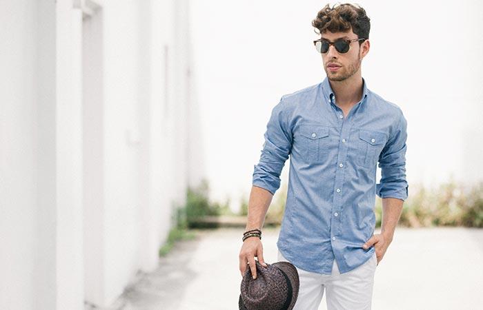 a guy wearing a blue Editor Utility Shirt