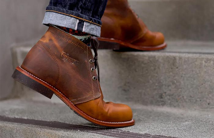 climbing the stairs in brown chukka boots