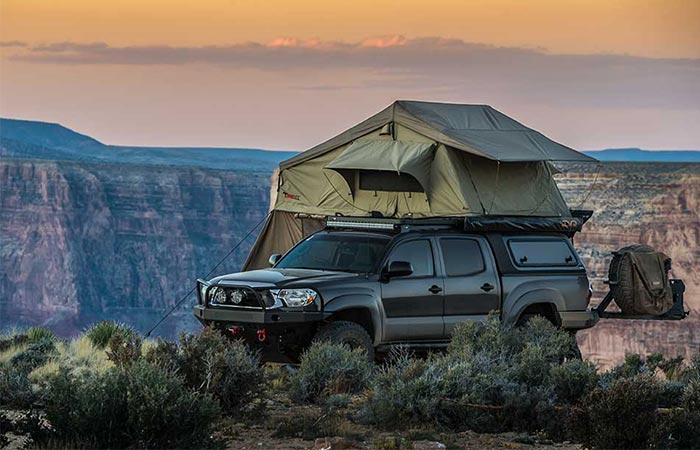 a car with a tent on its roof