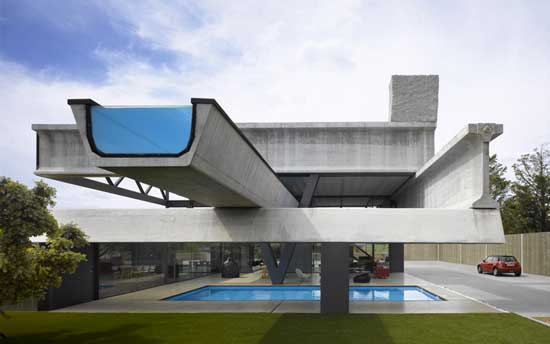 Exterior View Of A House Made Of Concrete And Pool