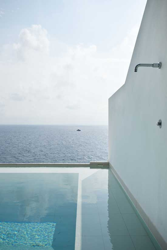 exterior view of a pool, shower and the sea
