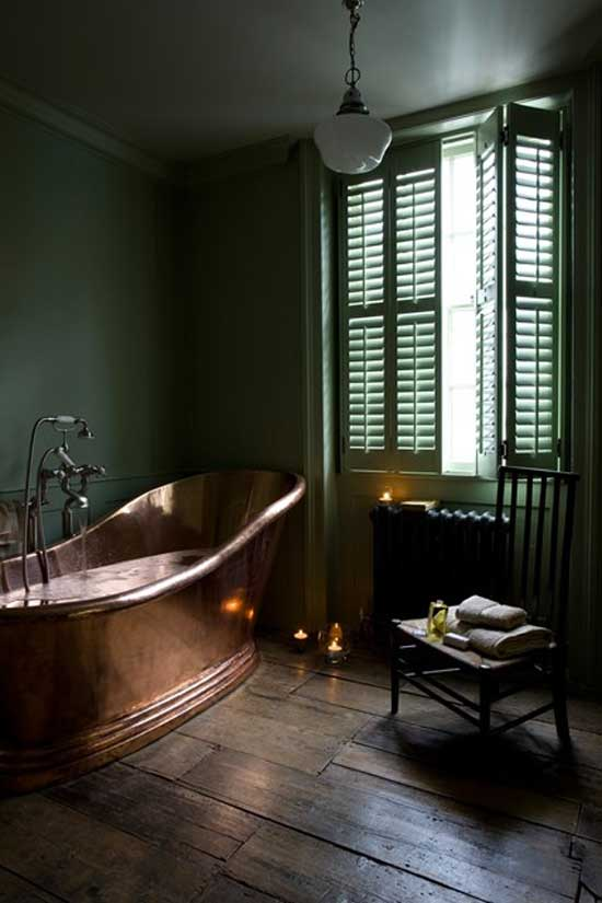 green tub brass bathroom