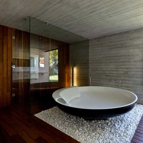 tub in glass bathroom