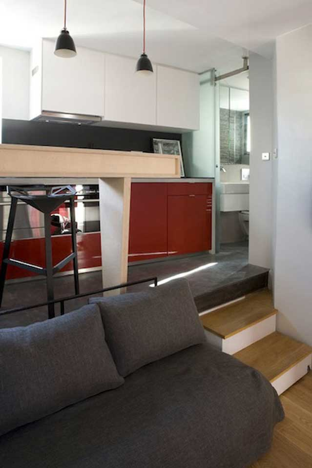 Micro Apartment in Paris couch and stairs