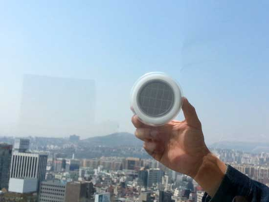 solar window socket by Kyuho mounted on a window