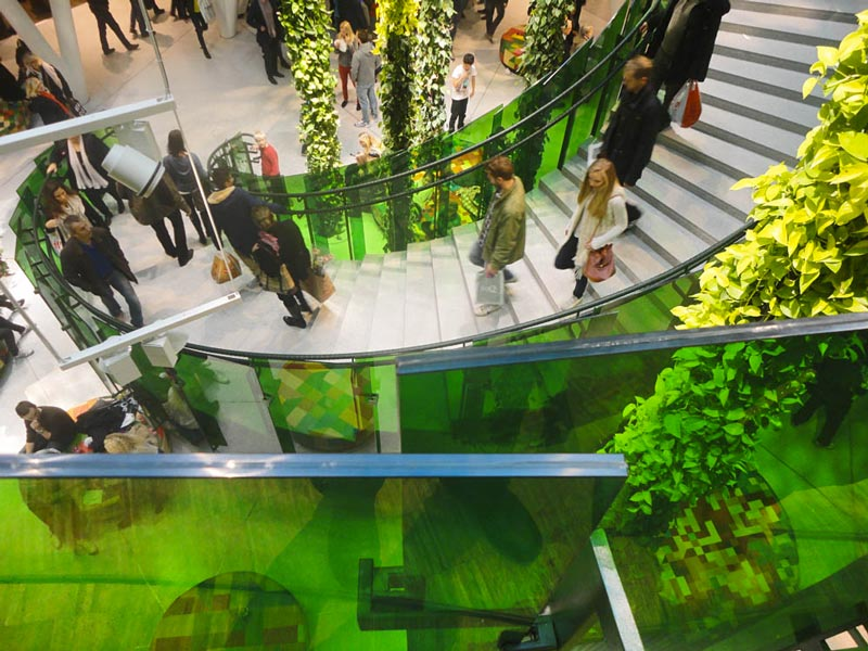 hanging plants and people walking on stairs at Emporia shopping center in Malmo, Sweden