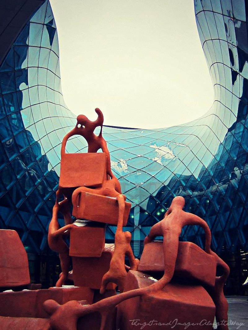 Red bronze sculpture and architecture outside of Emporia shopping center in Malmo designed by Wingårdhs Architects