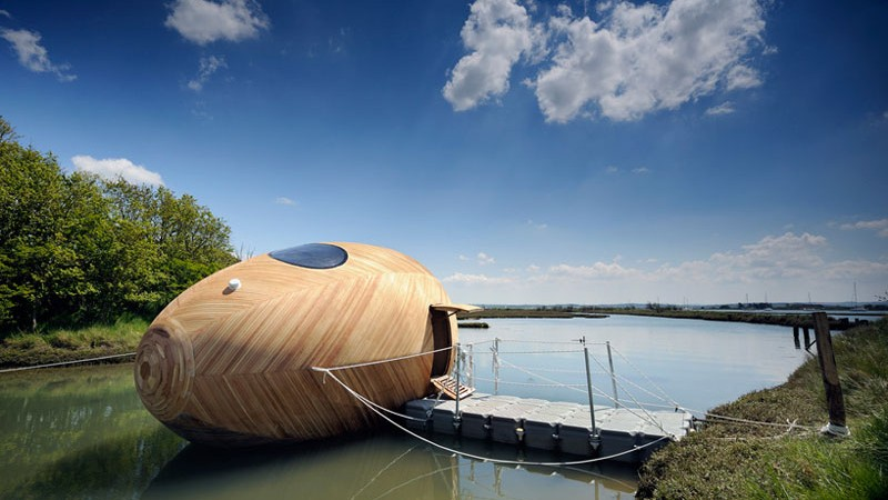 Exbury Egg docked on the water on a sunny summer day