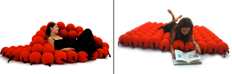 2 images of the red Feel Seating deluxe by Animi Causa with a woman lying down on top of it