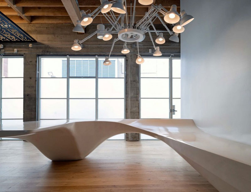 Reception desk and chandelier at Giant Pixel Headquarters in San Francisco designed by Studio O+A