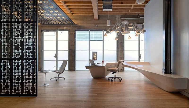 Reception desk, chairs and chandelier at Giant Pixel Headquarters in San Francisco designed by Studio O+A