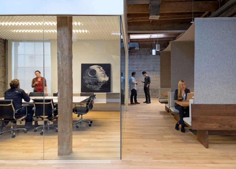 Employees in a conference room at the Giant Pixel headquarters in San Francisco designed by Studio O+A