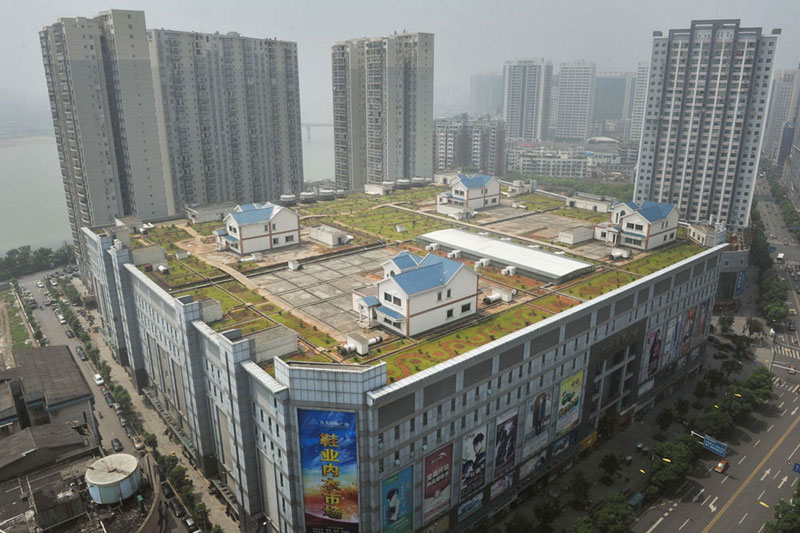 cityscape of Zhuzhou and houses on roof of shopping mall