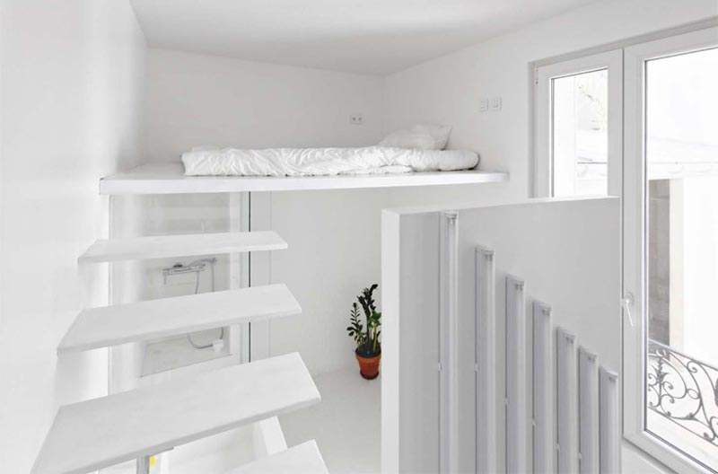 stairs and bedroom in a micro studio apartment in Paris