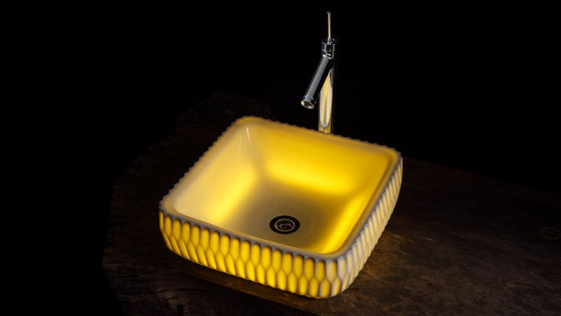 Rounded square LED Illuminated Ceramic Washbasin in the dark designed by Souhougama