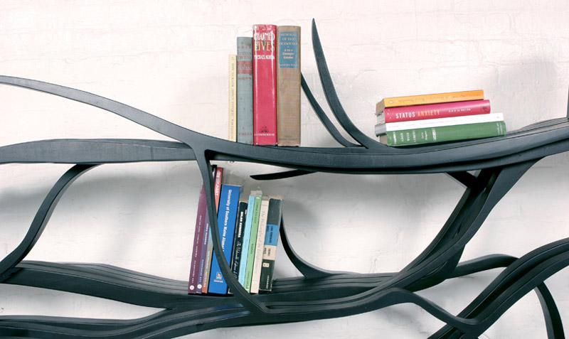 Closeup view of books stacked on a Metamorphosis Bookshelf
