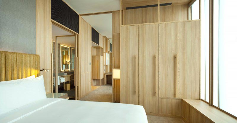 bed and closet at the Parkroyal Singapore