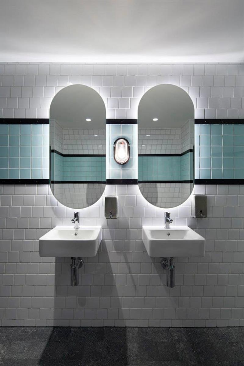 Bathroom sink and mirrors at Prahran Hotel