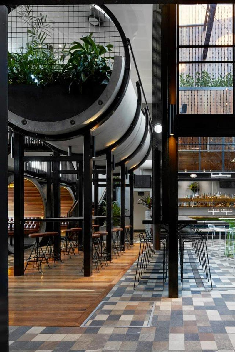 interior view of seating area with tables and chairs at Prahran Hotel