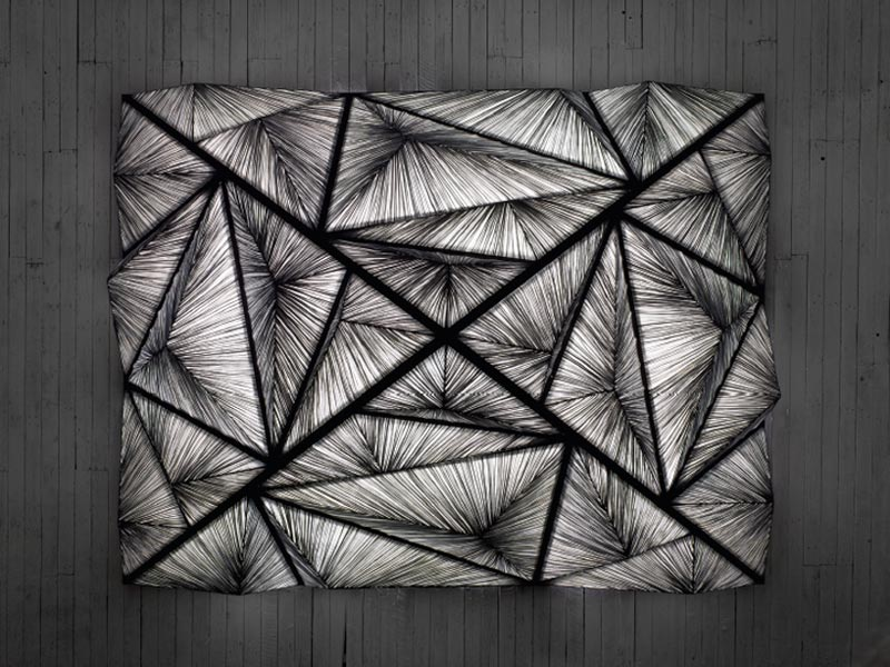 black and gray pyramid lighting sculpture
