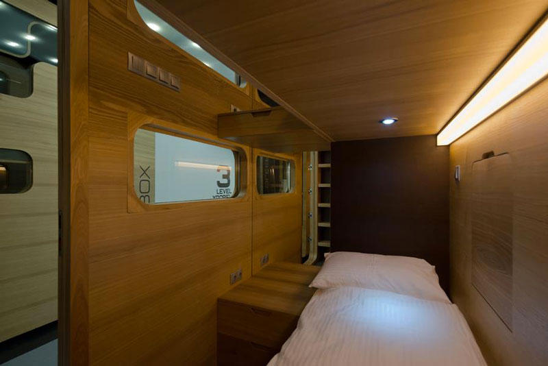 Interior view of room and bed of the Sleepbox Mobile Hotel in Tverskaya
