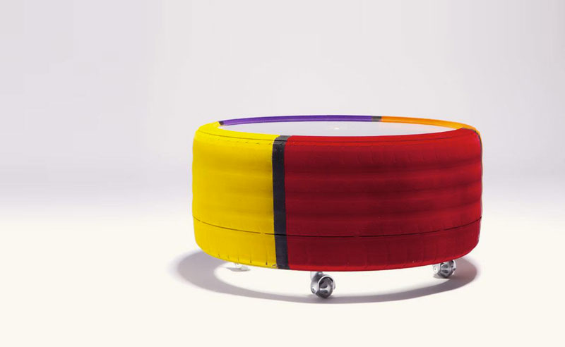 colourful tire table and clear plexiglass top