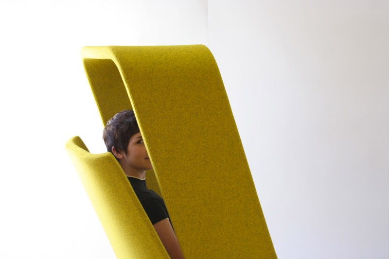 Woman sitting in a yellow Windowseat Lounge Chair