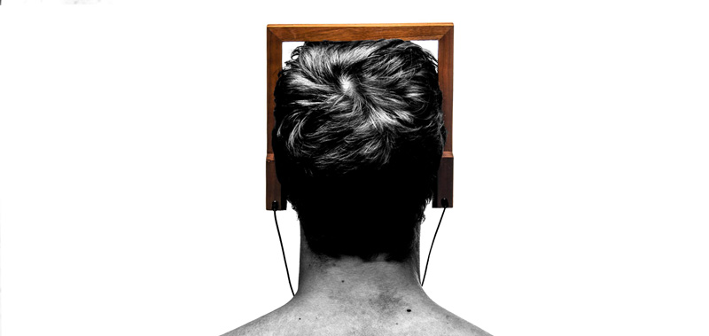 square wood head phones on a man's head