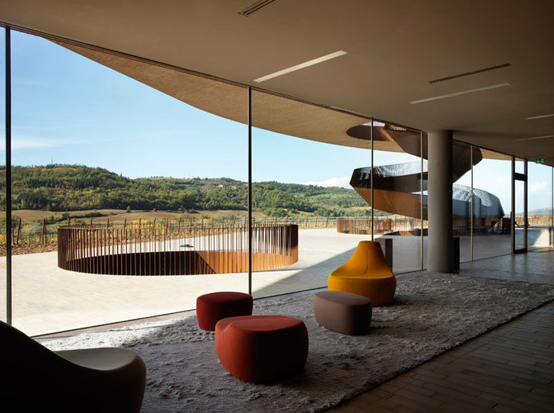 Lounge with a view of the exterior at the Antinori Winery by Archea Associati