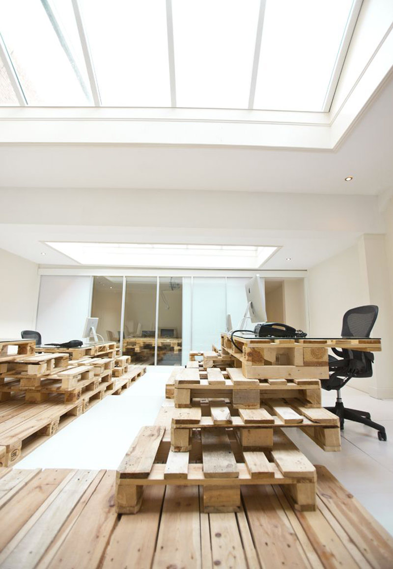Pallet tables and desks at the Brandbase Pallet Office by MOST Architecture