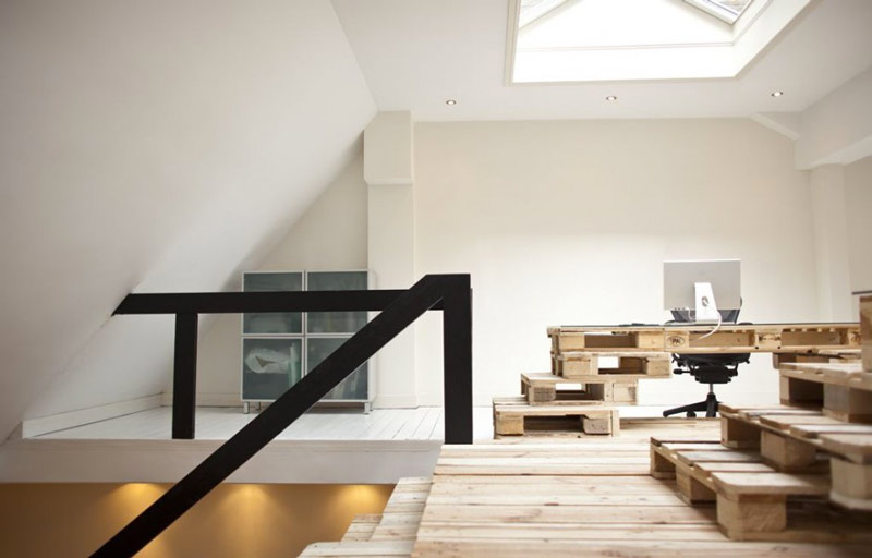 Pallet floors and tables at the Brandbase Pallet Office by MOST Architecture