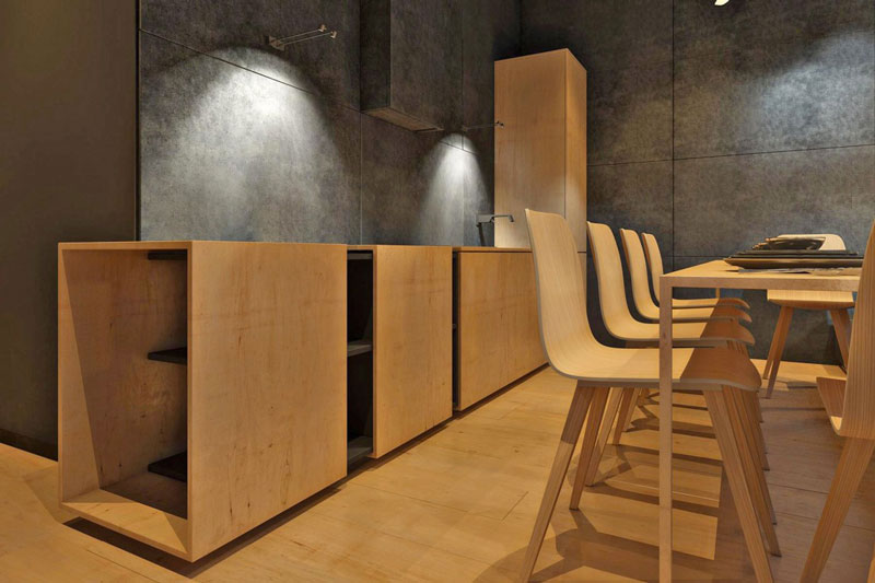 Kitchen and wooden dinner table and chairs at the Chair House by Igor Sirotov
