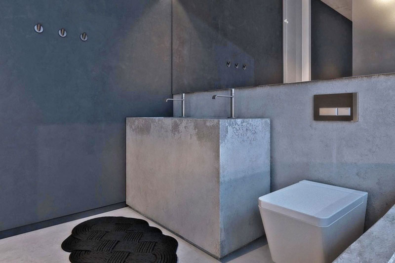 Concrete sink and mirror in the bathroom at the Chair House by Igor Sirotov Jebiga