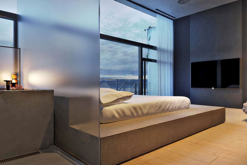Bedroom seperated with matte glass at the Chair House by Igor Sirotov
