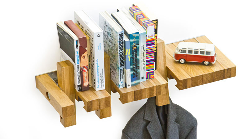 Books oraganized and a suit jacket hanging from the Fusillo Bookshelf by AndViceVersa