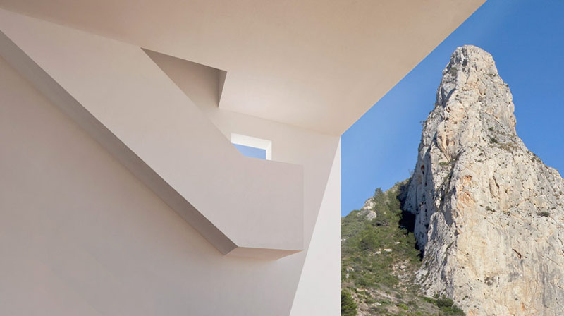 White walls and stairway of the House on the Cliff by Fran Silvestre Arquitectos
