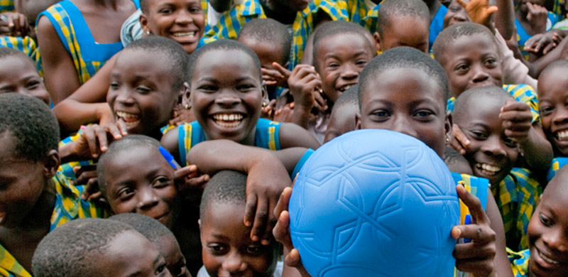 African children holding a blue One World Futbol Soccer ball