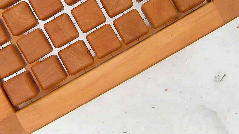Closeup of the wooden cubes and piano cables in the SQUAT chair by Martin Rille