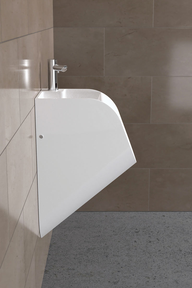Side view of a white sink urinal by TANDEM in a men's restroom