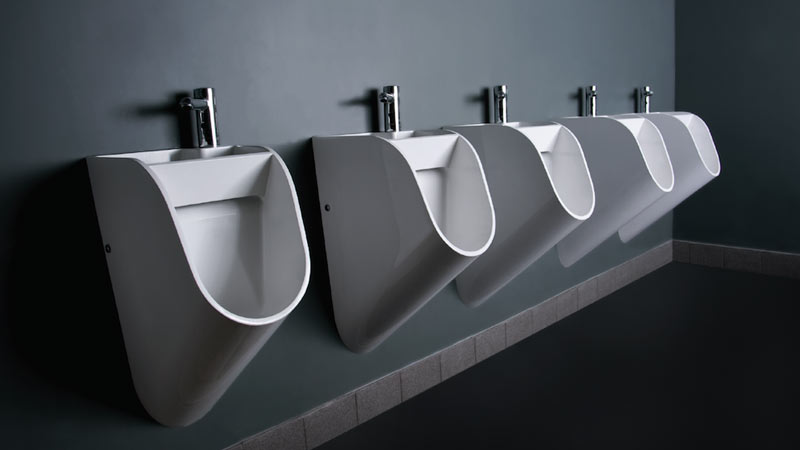 White sink urinals by TANDEM side by side in a men's restroom