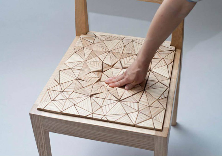 Triangular wooden pieces on the Squishy Chair by New Colony Furniture