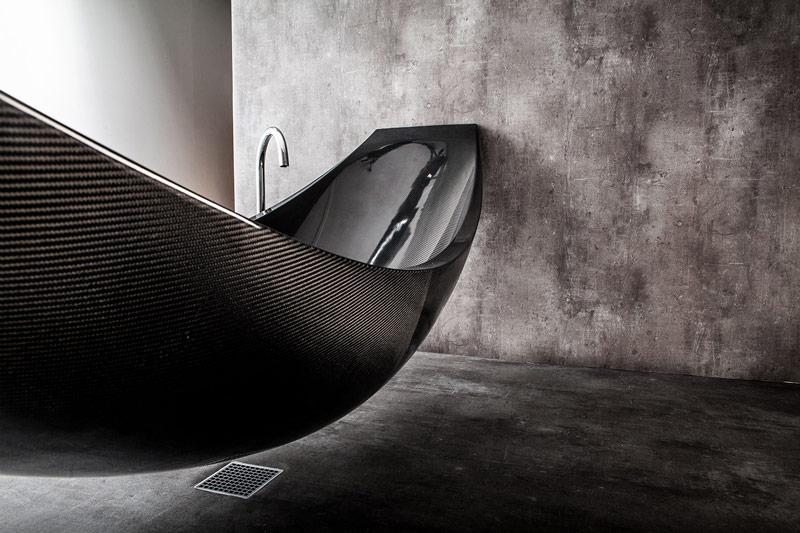 Vessel Hammock Bathtub in a minimal bathroom by Splinter Works