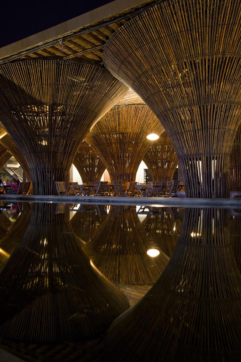 Large bamboo columns at the Kontum Indochine Cafe by Vo Trong Nghia Architects
