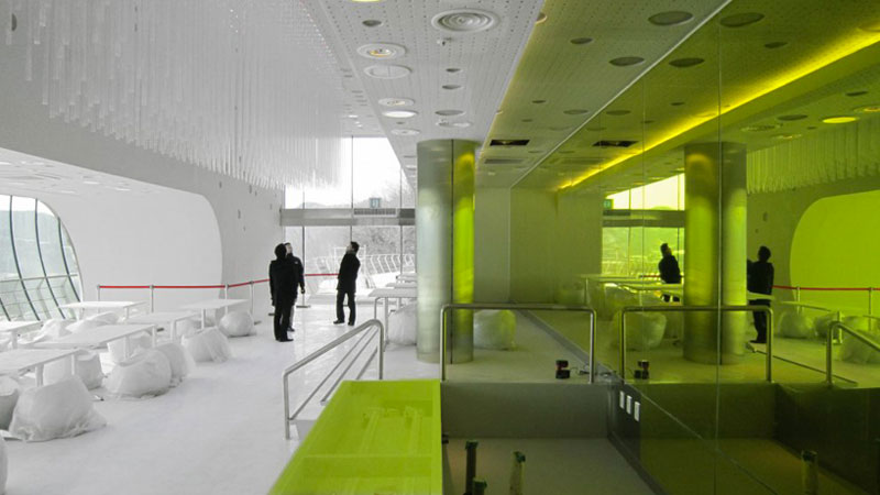 White and lime green interior design of the Jeongok Museum South Korea Prehistory Museum by X-TU Architects