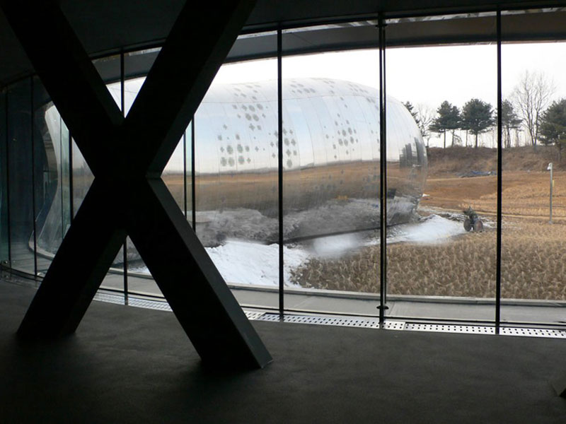 View of the outside from inside the Jeongok Museum South Korea Prehistory Museum by X-TU Architects