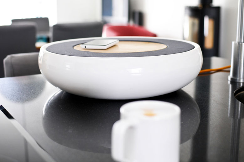 Ceramic Speaker for Smartphones by Victor Johansson on a table top with a smartphone on top of it