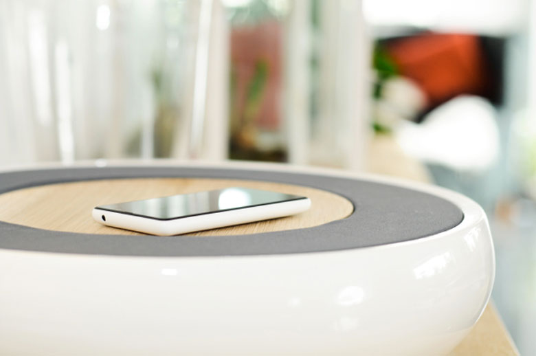 Smartphone on top of the Ceramic Speaker for Smartphones by Victor Johansson
