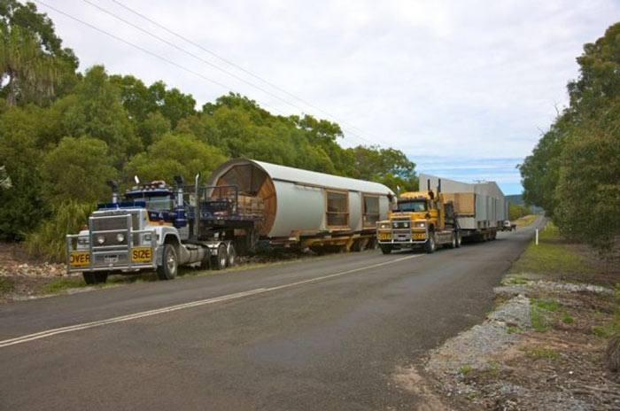 Truck hauling the prefab Drew House by Simon Hills of Anthill Constructions
